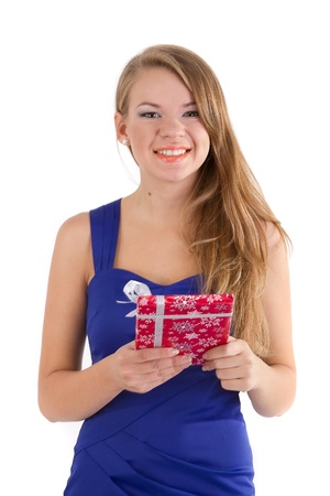 The smiling girl with a Christmas gift in hands photo
