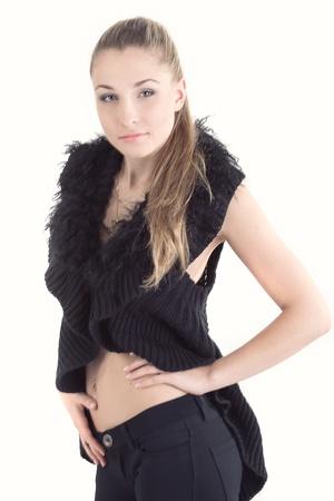 young beautiful girl in a black fur coat