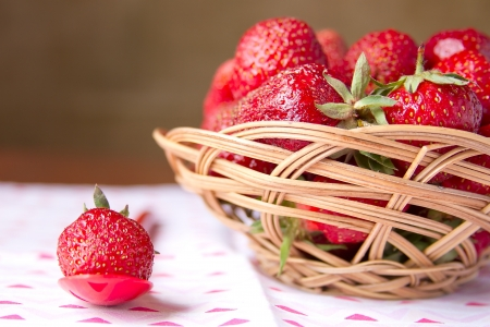 Fresh strawberries in a basket on a round table
