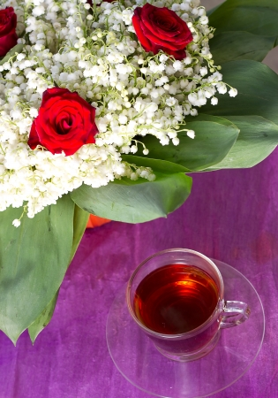 Lily of the valley and a tea Stock Photo