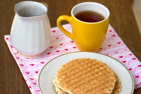 Round wafers with tea and honey for breakfast photo