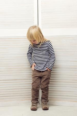 Blonde girl 3 years old dressed as a boy photo