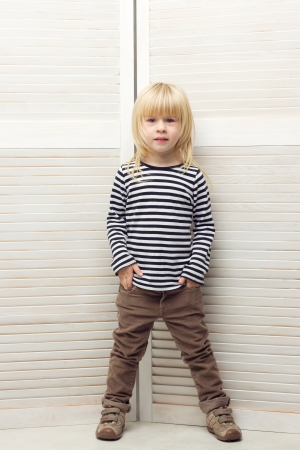 striped vest: Blonde girl 3 years old dressed as a boy