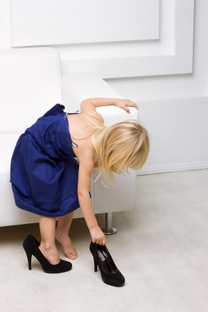 Little girl 3 years old standing near the white sofa in her mother Stock Photo - 16466598