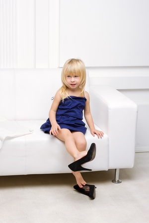 Little girl 3 years old sitting on a white sofa in her mother Stock Photo - 16466591