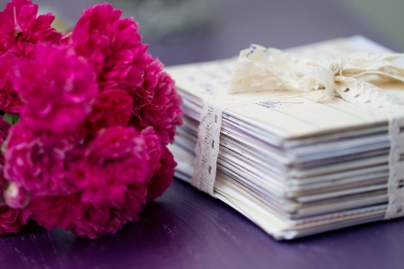 stack of old letters tied with lace ribbon with roses Stock Photo - 17329649