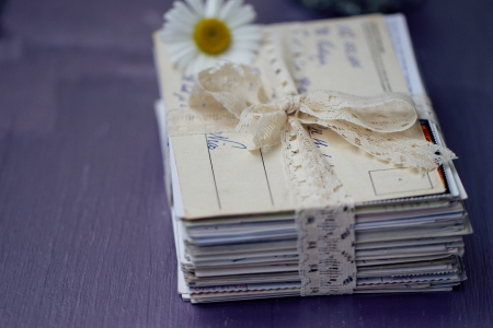 stack of old letters tied with lace ribbon with chamomile Stock Photo - 17329501