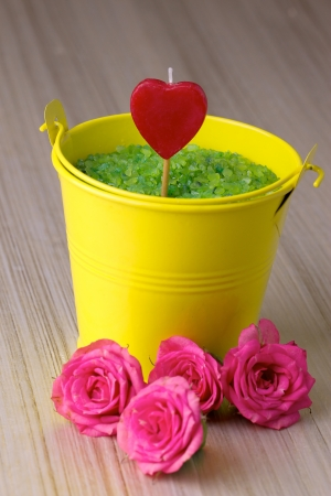 Small yellow bucket with a green sea salt photo