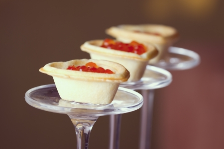 Tartlets with heart-shaped eggs on a glass base photo