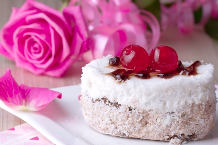 cakestand: Celebratory cake with cherries on a background of pink roses Stock Photo