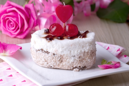 Celebratory cake with cherries on a background of pink roses photo