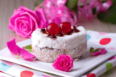 Celebratory cake with cherries on a background of pink roses Stock Photo - 17445293
