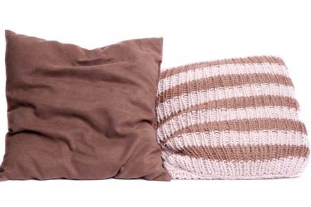 2 brown knitted pillow on a light background