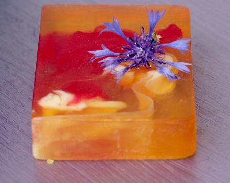 Natural soap with flower on purple cornflower table photo