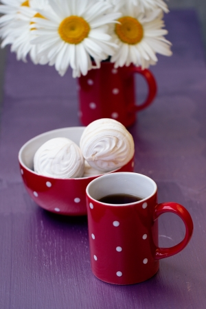 Red polka dot cup of tea, marshmallow and chamomile photo