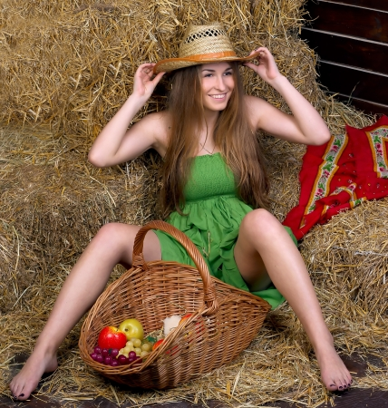 girl in a green dress in a haystack photo