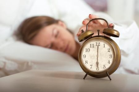 Woman's hand off the alarm clock, 6 am