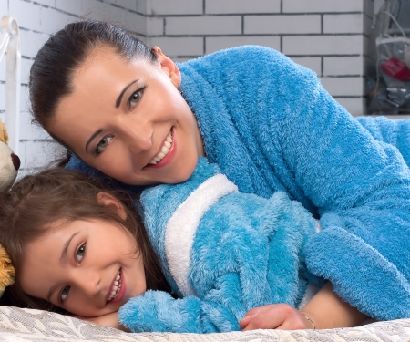 30 year old: 30 year old female and 5 year old girl in the same blue terry robes