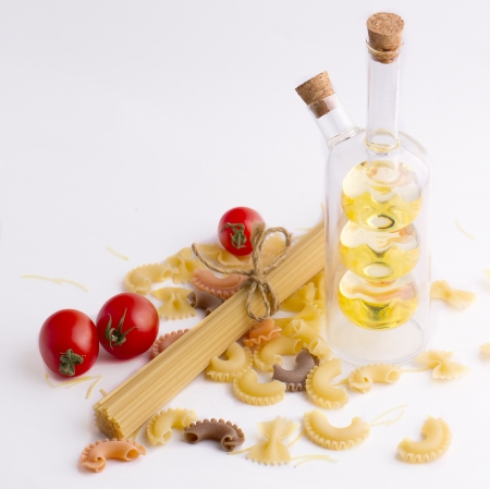 Multi-colored pasta isolated on a white background photo