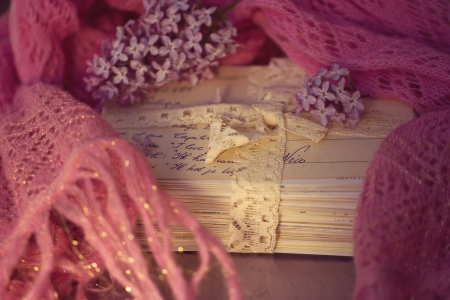 Stacks of old letters with lavender on soft scarf photo