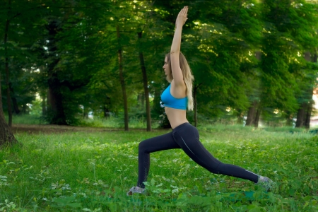 young woman makes stretching photo