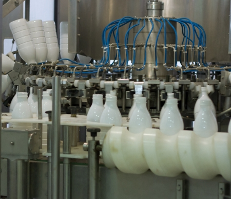 aseptic: Dairy Plant. Conveyor with milk  bottles.