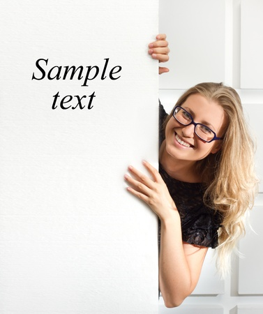 Cute Business Woman Holding A Blank Banner Board With Advertising Copyspace photo