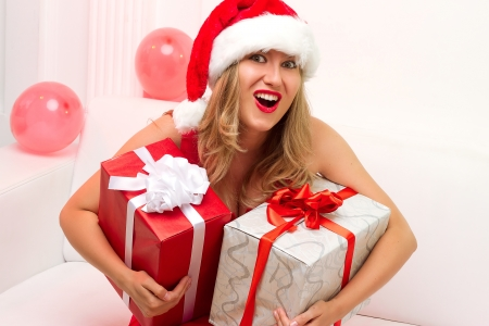 Christmas woman portrait hold red christmas gift photo