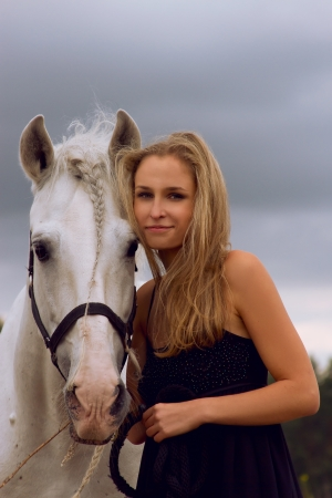 damsel: Blond girl with white horse Stock Photo
