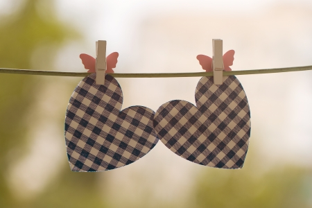 blue heart attached to a clothesline with pin photo
