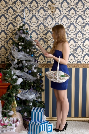tawdry: Young  girl dresses up Christmas tree