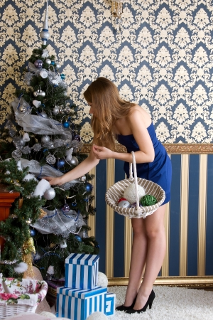 frippery: Young  girl dresses up Christmas tree