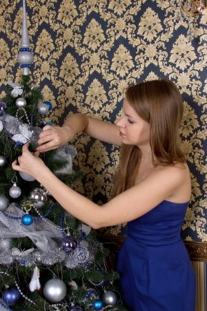 tawdry: Young  girl dresses up Christmas tree