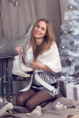Girl surrounded by festive Christmas paraphernalia photo