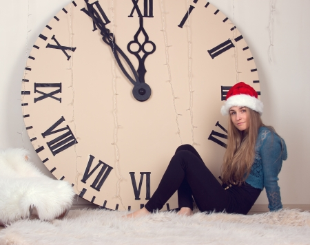 beautiful girl on clocks background lunch time photo