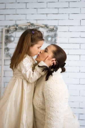 Mom and daughter in the winter holidays New Year and Christmas dresses photo
