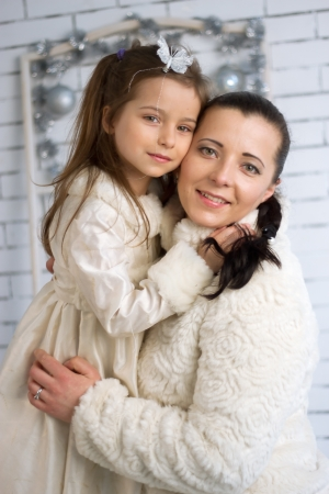 '5 december': Mom and daughter in the winter holidays New Year and Christmas dresses Stock Photo