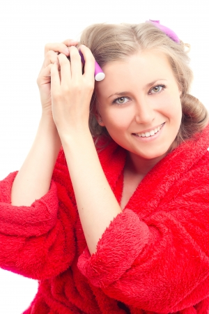 hair curlers: girl in a red robe removes hair curlers