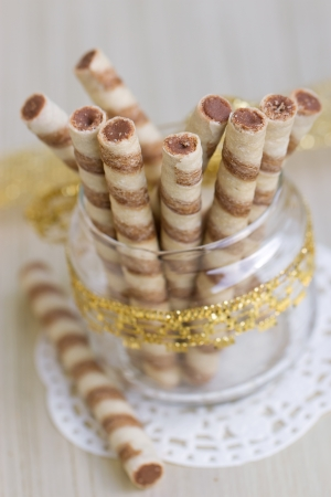 Wafer roll sticks cream rolls in a cup photo