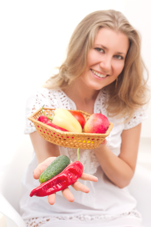beautiful young woman with fruits and vegetables photo