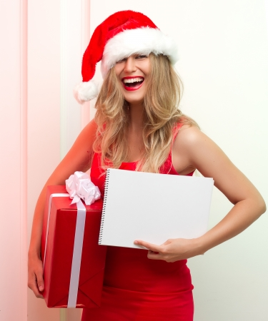 A Beautiful santa woman in red cloth with copyspace. photo