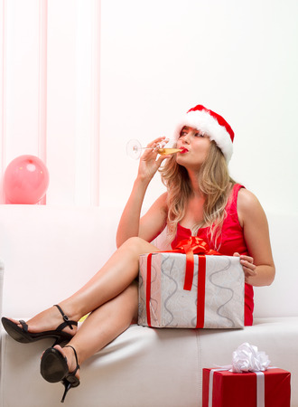 Christmas party girl with glasses of champagne photo