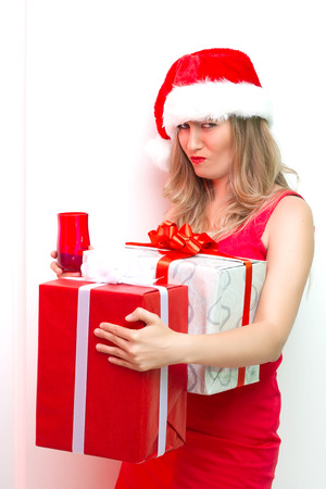 Young smiling woman hold christmas red gift box