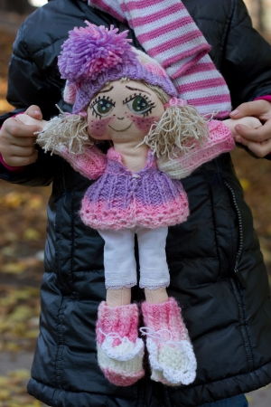Little girl with  baby doll photo
