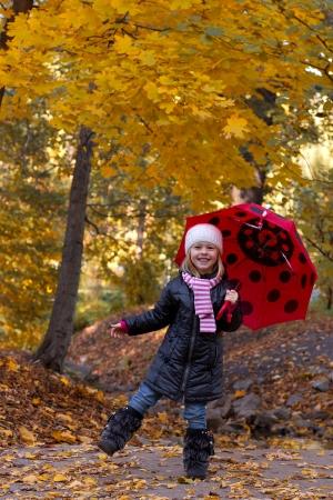 little girl with umbrella outdoor photo