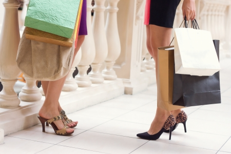 Beautiful girls with shopping bags walking in the store photo