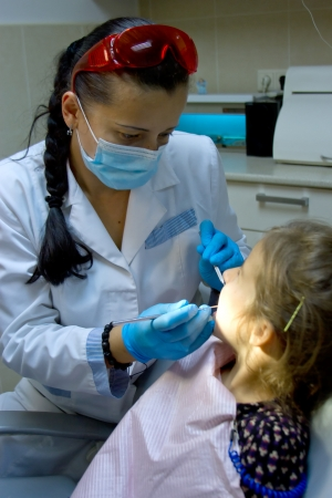 a girl at the dentist. photo