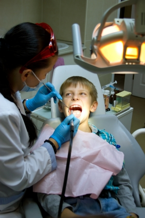 Shot of a little boy with a doctor in a dental surgery. Healthcare, medicine. Stock Photo