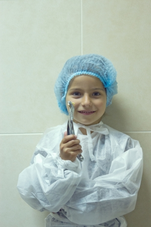 child playing in doctor dentist. Choosing a profession photo