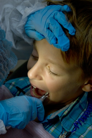 A couple of kids playing doctor at the dentist Stock Photo